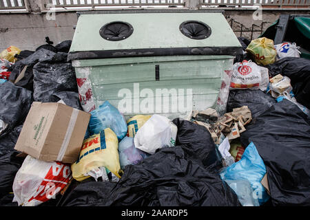 Caserta, Italy, February 21, 2008: Waste accumulates on a street in Caserta, Italy, north of Naples during the Naples waste management crisis in 2008. - Stock Photo