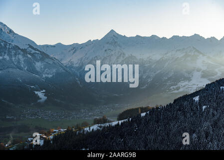 View of the mountain Kitzsteinhorn winter with the village of Kaprun in the valley. View from Keilberg, Schmittenhöhe, Zell am See, Salzburger Land, A - Stock Photo