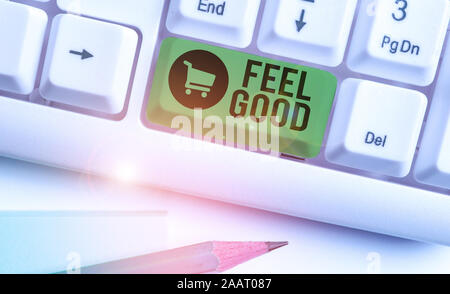 Writing note showing Feel Good. Business concept for relating to or promoting an often specious sense of satisfaction - Stock Photo