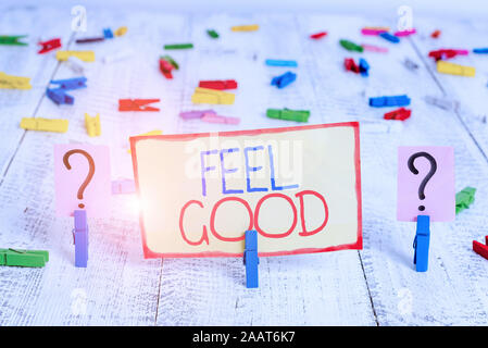 Word writing text Feel Good. Business photo showcasing relating to or promoting an often specious sense of satisfaction Scribbled and crumbling sheet - Stock Photo