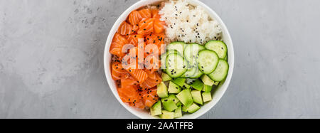Hawaiian salmon bowl with cucumbers, avocado, sesame seeds and rice. Top view, overhead, flat lay, mock up, template. Healthy food concept - Stock Photo