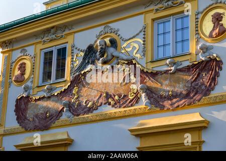 Chronos sundial on south facade of Wilanow Palace in Warsaw, Poland, Baroque residence of King Jan III Sobieski, 17th century bas-relief of Chronos - - Stock Photo