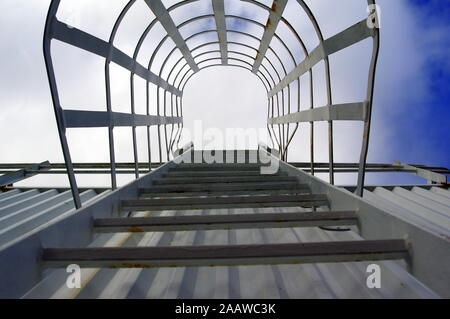 Iron stairs in an old industrial building - Stock Photo