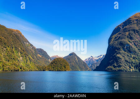 Scenic view of Doubtful Sound against blue sky in Fiordland National Park at Te Anau, South Island, New Zealand