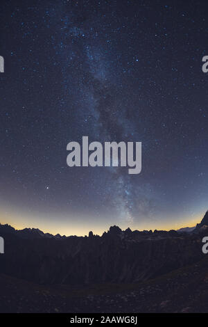Idyllic shot of milky way over Alps, Italy - Stock Photo