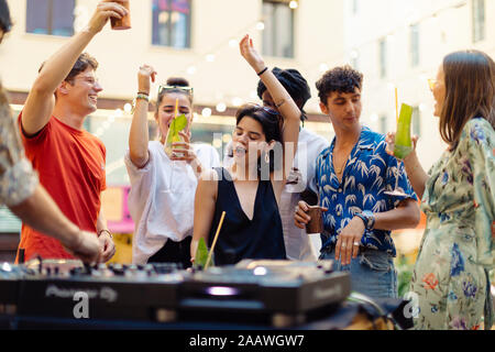 Happy multi-ethnic friends having fun during a party - Stock Photo