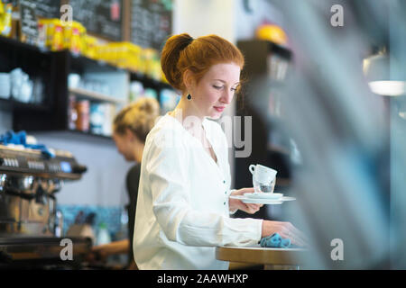 Young woman working in coffee shop