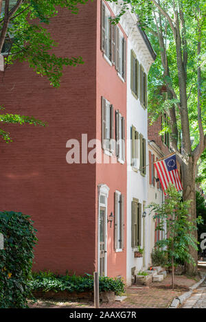 Historic buildings and tall trees line Quince St, one of Philadelphia's narrowest alleys.