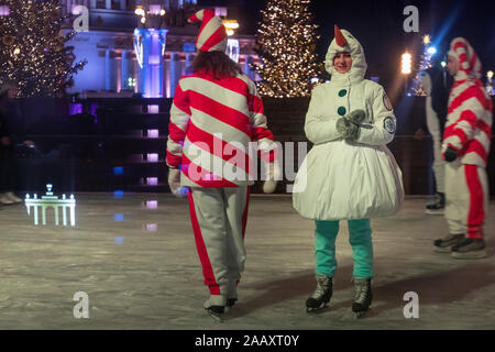 Moscow, Russia. 22nd of November, 2019 Artists in funny costumes of snowmen and candies during the Grand opening of the winter season at the ice rink at the Exhibition of Achievements of National Economy (VDNKh) in Moscow, Russia Stock Photo