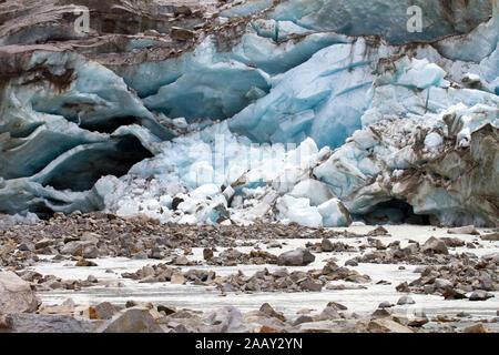 Alpine glacier in retreat - iceberg - Stock Photo