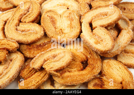 multiple layered shortbread cookies on white isolated background - Stock Photo