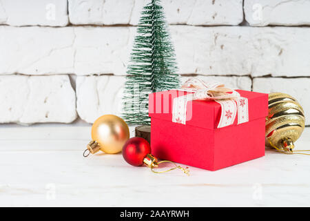 Christmas background. Red and golden decorations on white.