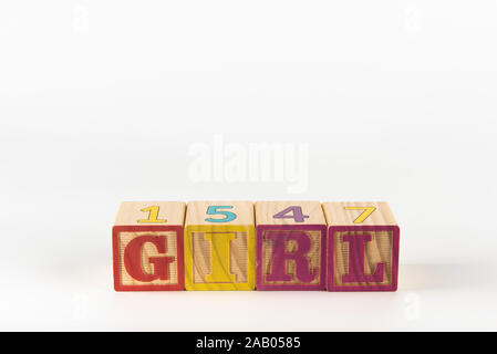 A child's alphabet toy spelling word block set, spelling out the word girl. - Stock Photo