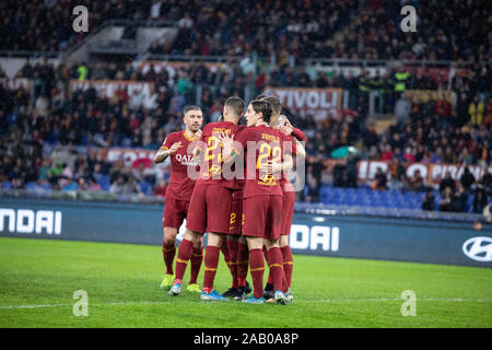 Edin Dzeko of AS Roma celebrates a goal with his teammates during the Italian Serie A football match between AS Roma and Brescia at the Olympic Stadium in Rome.(Final score; AS Roma 3:0 Brescia) - Stock Photo