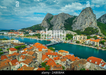 Amazing mediterranean cityscape with Cetina river and red roofs. Beautiful travel and rafting place, Omis, Dalmatia, Croatia, Europe - Stock Photo
