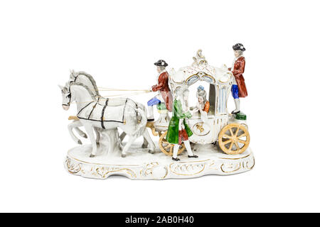 porcelain figurines of horse carriage on white background (with clipping path). - Stock Photo