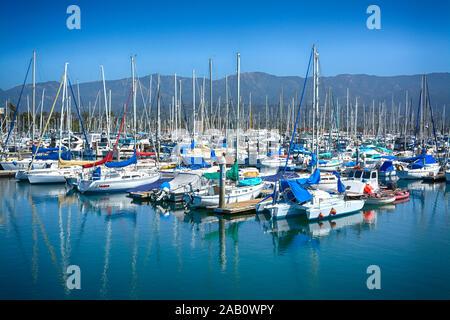 A picturesque view of moored sailboats against the backdrop of the Santa Ynez Mountains at the Santa Barbara Harbor, Santa Barbara, CA, USA, - Stock Photo