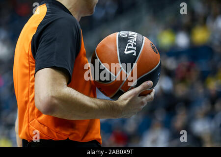 Berlin, Germany, October 04, 2019:a referee holds the official basket game ball during a EuroLeague match between Alba Berlin and Zenit - Stock Photo