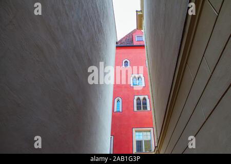 narrow street view between the buildings - Stock Photo
