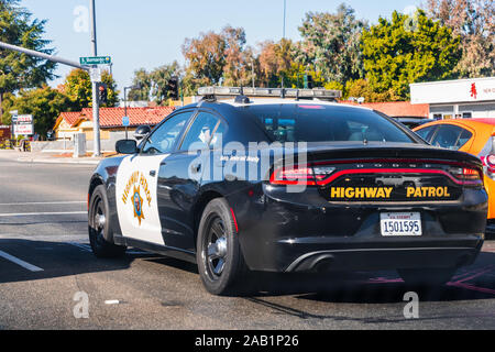 Nov 23, 2019 Redwood City / CA / USA - Highway Patrol vehicle driving on a street in San Francisco Bay Area; The California Highway Patrol (CHP) is a - Stock Photo