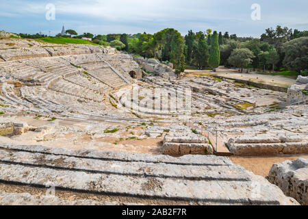 View to auditorium of the ancient Greek theatre (Teatro Greco) in Syracuse. Sicily, Italy - Stock Photo