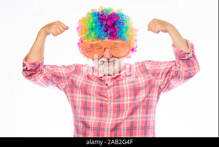 Having fun. Funny lifestyle. Fun and entertainment. Comic grandfather concept. Nice joke. Elderly clown. Man senior bearded cheerful person wear colorful wig and sunglasses. Grandpa always fun. - Stock Photo