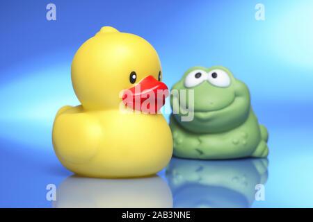 Gummiente mit Frosch - Stock Photo