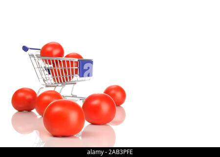 Einkaufswagen und Tomaten - Stock Photo