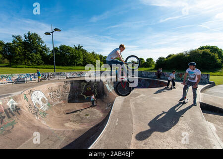 Pro, Professional BMX riders compete in a annual competition at the Stoke on Trent skatepark, riding around the park, bowl and walls performing tricks