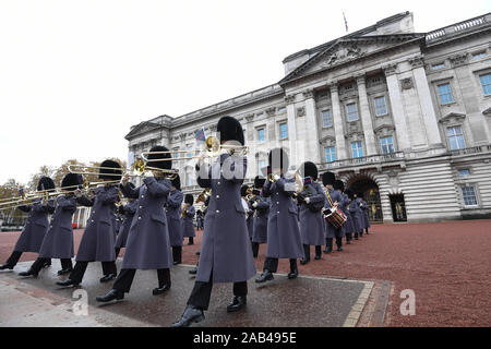 Band of the Grenadier Guards exit the forecourt, as sailors from the Royal Navy perform the Changing of the Guard ceremony at Buckingham Palace, London, for the second time in its 357-year history. - Stock Photo