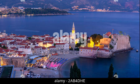 Panoramic night view of The Old Town of Montenegrin town Budva on the Adriatic Sea, Montenegro - Stock Photo