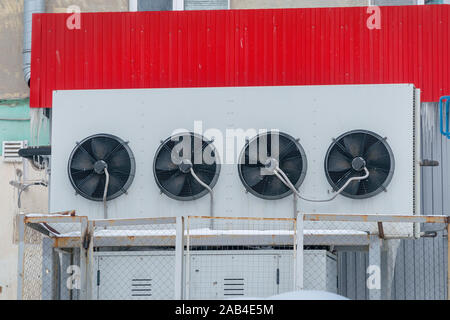 Industrial air conditioning system. Large fans on the wall of the building - Stock Photo