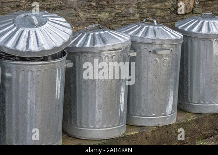 Row of lidded galvanised domestic dustbins. Metaphor dustbin of history, domestic refuse, household rubbish, data deletion, file deleted, data deleted - Stock Photo