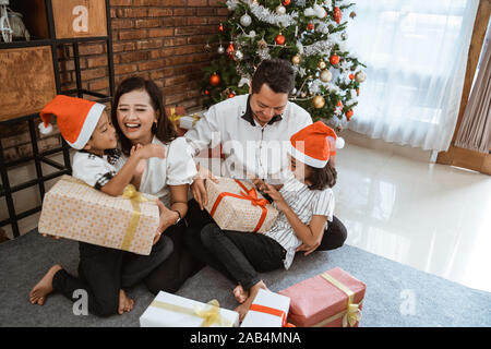 family with children playing on christmas - Stock Photo