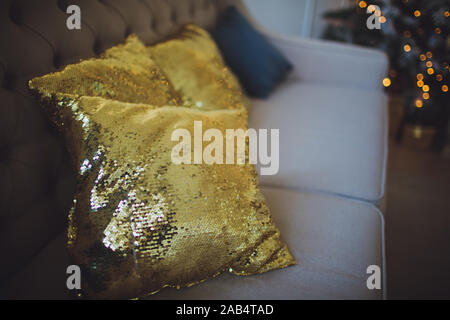 Fashionable pillows with sequins gold color. Close up - Stock Photo