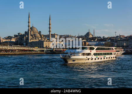ISTANBUL, TURKEY - APRIL 11, 2014: Galata Bridge over Golden Horn. Fish restaurants and shops on the first floor. - Stock Photo