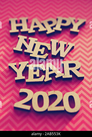 Vertical red Happy New Year 2020 background edited with film filter effect for poster - Stock Photo