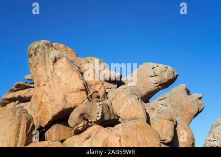 Strange rock formations and water / wind eroded boulders along the Côte de granit rose / Pink Granite Coast, Côtes d'Armor, Brittany, France - Stock Photo