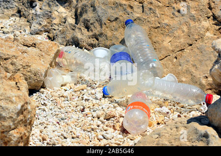 plastic bottles on the beach - Stock Photo