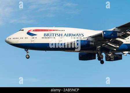 A British Airways Boeing 747-400 four engine airliner, known as the jumbo jet, approaching London Heathrow after a long haul flight. - Stock Photo