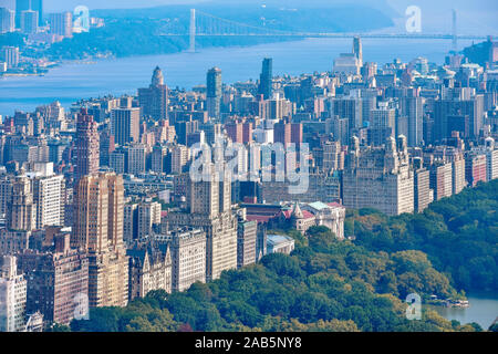 Aerial view of Central Park and row of buildings on the Upper West Side. Hudson River and George Washington Bridge in the background. Manhattan, New Y - Stock Photo