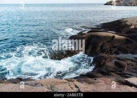 Waves of Norwegian sea on rocky beach of fjord. Ramberg beach, Lofoten islands, Norway - Stock Photo