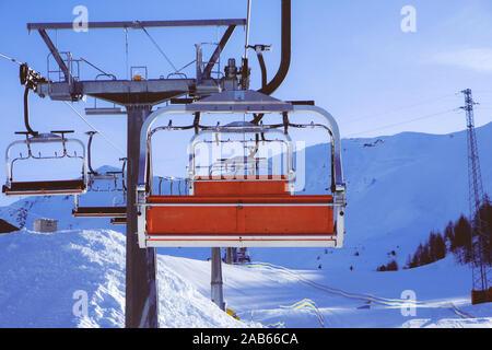 Chairlift or elevated passenger ropeway at ski area. Winter ski resort. - Stock Photo