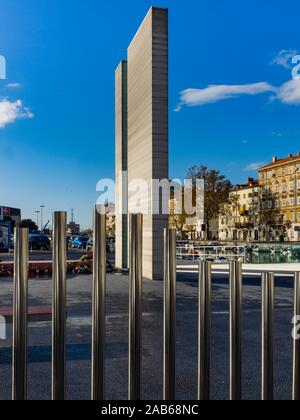 Parking lot place Delta music tubes and war monument  in town Rijeka in Croatia - Stock Photo