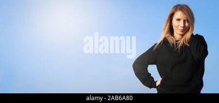 Young casual happy woman on light blue long banner background with copy space - Stock Photo