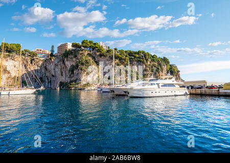 Sailboats and yachts moored in the Fontvieille Port along the Riviera in Monaco. - Stock Photo