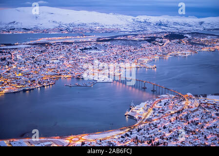 Above view of beautiful winter landscape of snow covered town Tromso in Northern Norway