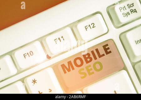 Conceptual hand writing showing Mobile Seo. Concept meaning process of optimizing a website to rank for mobile searches - Stock Photo