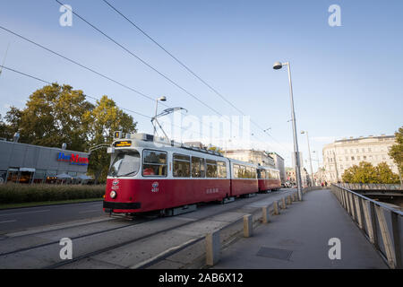 VIENNA, AUSTRIA - NOVEMBER 6, 2019: Vienna tram, also called strassenbahn, an old and traditional modern, passing by on the iconic ringstrasse in the - Stock Photo
