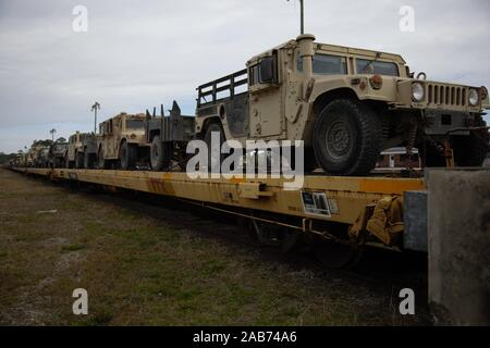 U.S. Marine Corps vehicles from II Marine Expeditionary Force arrive on rail carts during rail transportation operations headed by Marines of 2nd Transportation Support Battalion, Combat Logistics Regiment 2, 2nd Marine Logistics Group at Marine Corps Base Camp Lejeune on Nov. 22, 2019. The Marine vehicles loaded by 2nd TSB were used in MAGTF Warfighting Exercise 1-20. (U.S. Marine Corps photo by Cpl. Dominique Osthoff) - Stock Photo
